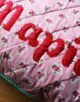 Quilted pillow cover name applique